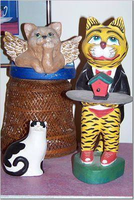 Cat figurines with birdhouse