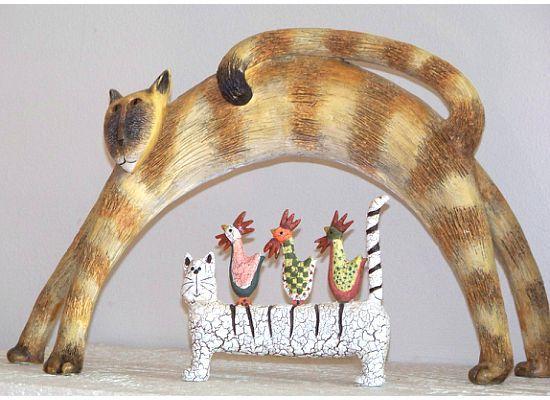 Cat figurines on mantle