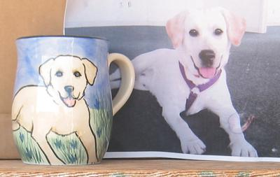 A customer's pet portrait on a mug.