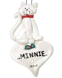 White cat on top of heart ornament