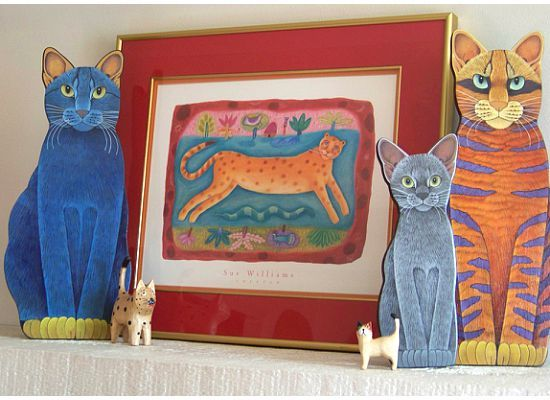Cat art on mantle with print